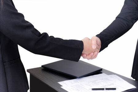Two businessmen shake hands when they sign contract finish on white background with clipping path. 版權商用圖片