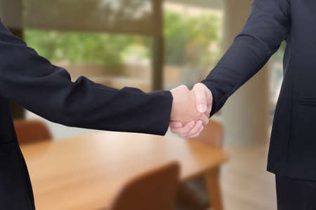 Man and woman shake hands in the office.