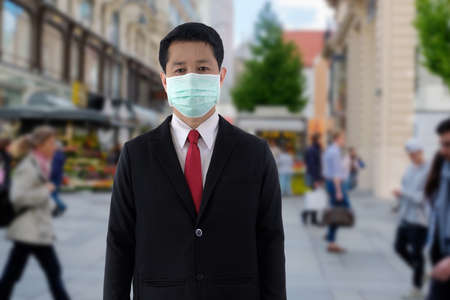 Businessman wears mask when he is going to a place with many people.