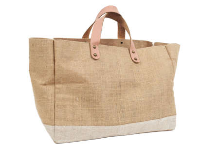Big canvas bag on white background.