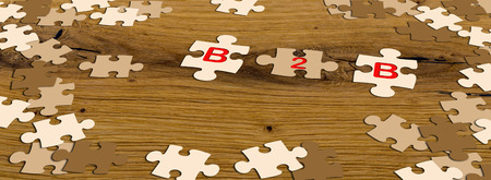 ecru: b2b - ecru puzzle pieces on wooden table