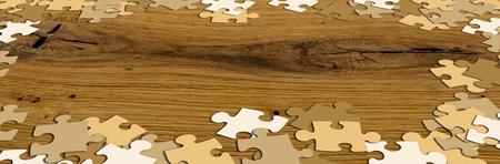 ecru: ecru puzzle pieces on rustic wooden table
