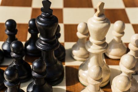 symbols  metaphors: chessmen face to face