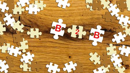 b2b: puzzle pieces on wooden table - b2b Foto de archivo