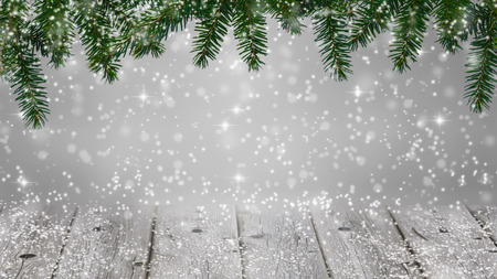 porch scene: christmas background - snowfall on christmas fir and wooden deck