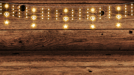 wooden background with garland of holiday lights