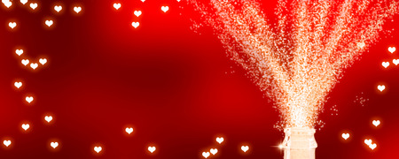 frame of bright hearts with fizzing champagne Stock Photo