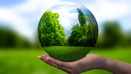 globe in a open hand