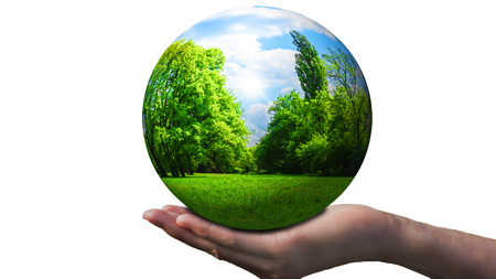 nature in a crystal ball on a open hand