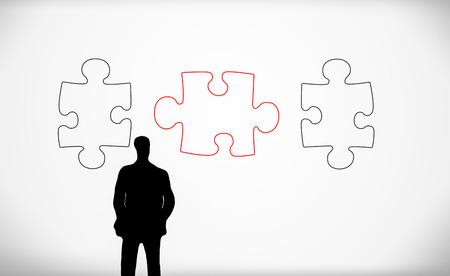 puzzelstukjes en zakelijke man silhouet Stockfoto