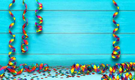 colorful party background with party streamers and confetti