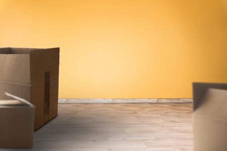 Open cartons in an empty room