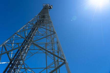telephone tower against sunlight