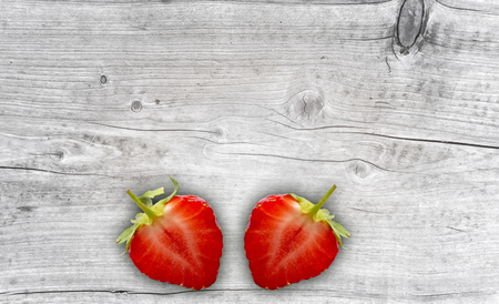 two delicious stwaberries on rustic wooden background Banco de Imagens