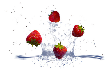 strawberries are falling into the fresh water