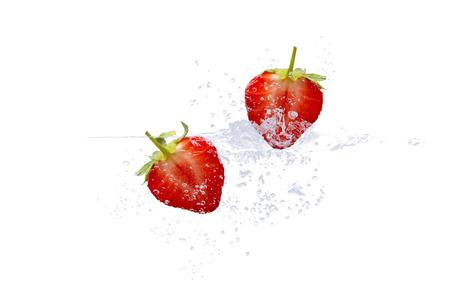 fresh strawberries in splashing water