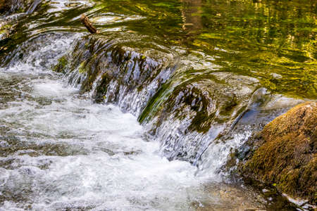 Dovedale-Flowing water over stones in a nature reserve in England Stock fotó