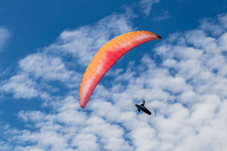 Colorful parachute on a blue sky background in the Peack District
