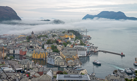 Alesund town with fog in the morning, Norway. Stock Photo
