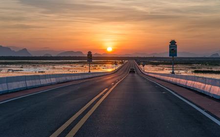 Sunset and the longest bridge in Thailand. Stock Photo
