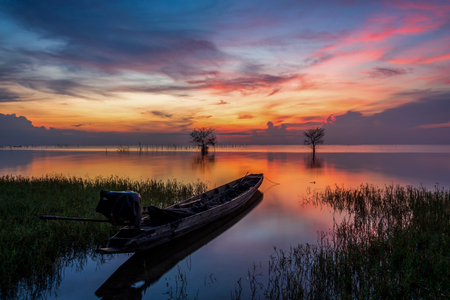 Fisherman boat and beautiful morning twilight. Stok Fotoğraf