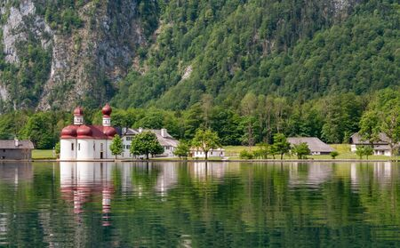 Bartholomew church in Konigssee , the deepest, cleanest lake in Germany during summer season.