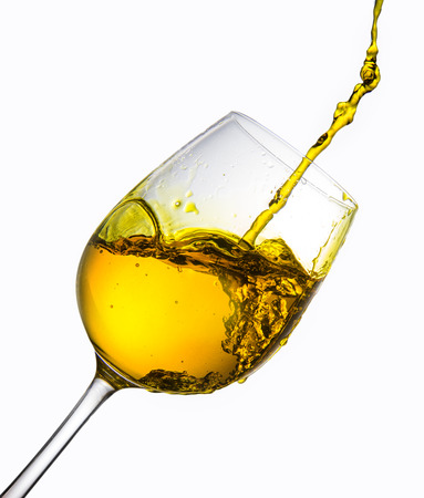 wine being poured into glass on white background
