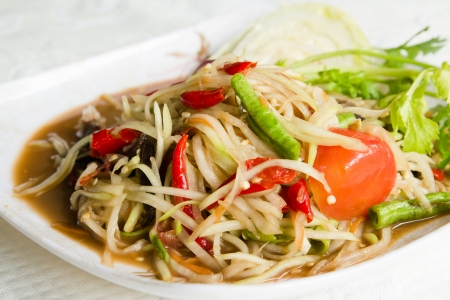 Somtam Thai food hot and spicy papaya salad photo