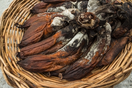 moulder: Bunch of rotten banana in basket Stock Photo
