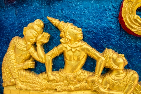 Traditional Thai art on a temple wall of Thailand photo