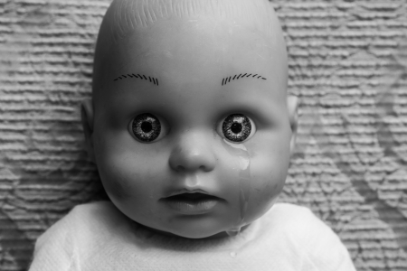 Close up of doll face with tear photo