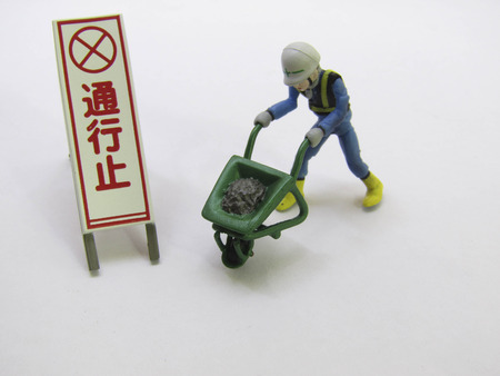 Miniature models are operating with warning signs.