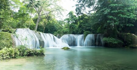 Chet Sao Noi Waterfall in tropical rainforest with rock and turquoise blue pond has 7 tiers, Seven leveled falls are one of most beautiful waterfalls in Thailand. Namtok chet saonoi National Park