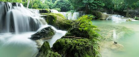 Chet Sao Noi Waterfall in tropical rainforest with rock and turquoise blue pond has 7 tiers, Seven leveled falls are one of most beautiful waterfalls in Thailand.  Namtok chet saonoi National Park Stock Photo