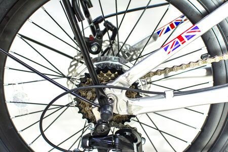 Close up wheel and chain of mountain biking. Landscape view of disc break system and front Derailleur of moutain bike. bicycle parts titanium color and frame aluminium. Shift lever and brake lever. Standard-Bild