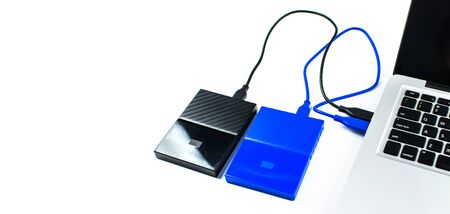 Close up of external hard disk drive for connect to laptop, transfer or backup data between computer and HDD. Black hard disc for backup files and important information using USB 3.0 connection