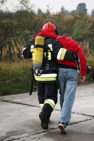 firemen in action, exercises Firefighters train accident Stock Photo