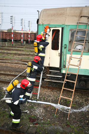 derail: firemen in action, exercises Firefighters train accident Stock Photo