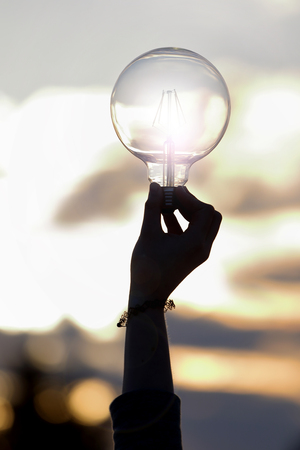 creativ: sunshine light bulb Stock Photo
