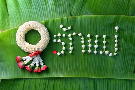 Thai traditional jasmine garland is a symbol of Mothers day in Thailand with the Love Mother  in Thai word. Stock Photo