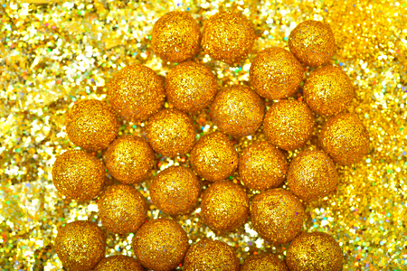 christmas tree illustration: shiny sphere made of golden glitters with sparkles and glares.