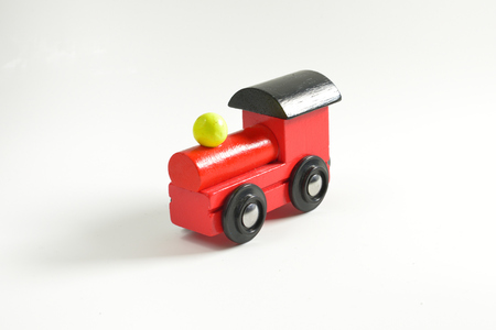 black block: Wooden toy train with colorful blocs isolated on white background.