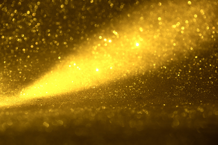 golden glitter texture Colorfull Blurred abstract background for birthday, anniversary, wedding, new year eve or Christmas.