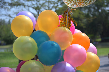 Colorful balloons with celebration and various party confetti.