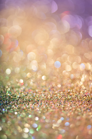 glitter gold bokeh Colorfull Blurred abstract background for birthday, anniversary, wedding, new year eve or Christmas. Stock Photo