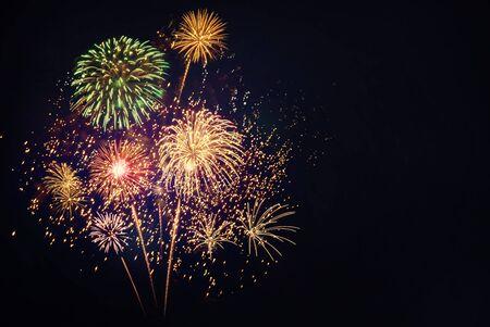 Colorful fireworks for celebrations on black background.