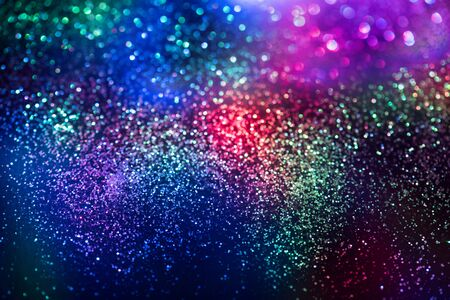 glitter bokeh lighting effect Colorfull Blurred abstract background for birthday, anniversary, wedding, new year eve or Christmas. Stock Photo