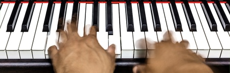 Hands on piano keyboard photo