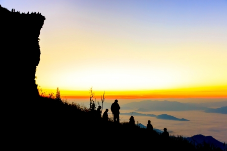 Group of people on top of a mountain at  phu chifa at Chiangrai, Thailand photo