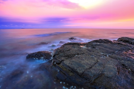 con dao: sea and stone beach on sunset